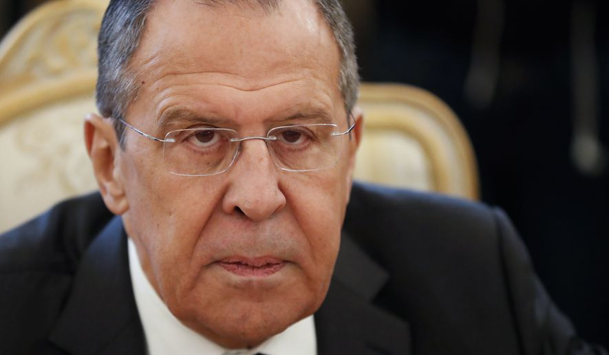 Russian Foreign Minister Sergey Lavrov listens to Venezuela's Vice President Delcy Rodriguez during their talks in Moscow, Russia, Friday, March 1, 2019. (AP Photo/Pavel Golovkin)