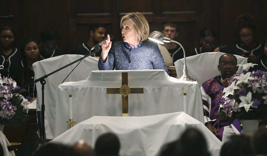 "Former Secretary of State Hillary Clinton speaks during a commemorative service marking the anniversary of ""Bloody Sunday""  at Brown Chapel AME Church in Selma, Ala., Sunday, March 3, 2019. Several Democratic White House hopefuls are visiting one of America's seminal civil rights sites to pay homage to that legacy and highlight their own connections to the movement.  (AP Photo/Julie Bennett)"