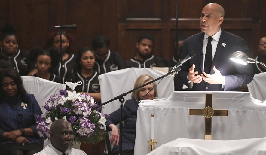 U.S. Sen. Cory Booker, D-N.J., speaks during a commemorative service Sunday, March 3, 2019, at Brown Chapel AME Church in Selma, Ala. Several Democratic White House hopefuls are visiting one of America's seminal civil rights sites to pay homage to that legacy and highlight their own connections to the movement. (AP Photo/Julie Bennett)