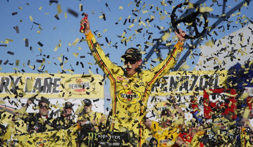 Joey Logano celebrates after winning a NASCAR Cup Series auto race at Las Vegas Motor Speedway, Sunday, March 3, 2019, in Las Vegas. (AP Photo/John Locher)