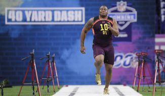 Clemson defensive lineman Dexter Lawrence runs the 40-yard dash at the NFL football scouting combine in Indianapolis, Sunday, March 3, 2019. (AP Photo/Michael Conroy)