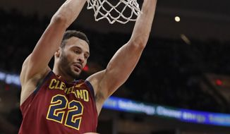 Cleveland Cavaliers' Larry Nance Jr. dunks against the Orlando Magic in the first half of an NBA basketball game, Sunday, March 3, 2019, in Cleveland. (AP Photo/Tony Dejak)