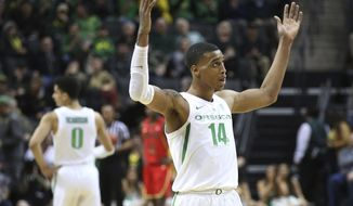 Oregon's Kenny Wooten gestures to the crowd at the end of the team's NCAA college basketball game against Arizona on Saturday, March 2, 2019, in Eugene, Ore. (AP Photo/Chris Pietsch)