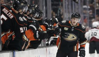 Anaheim Ducks' Jakob Silfverberg (33) celebrates his goal with teammates during the first period of an NHL hockey game against the Colorado Avalanche, Sunday, March 3, 2019, in Anaheim, Calif. (AP Photo/Marcio Jose Sanchez)