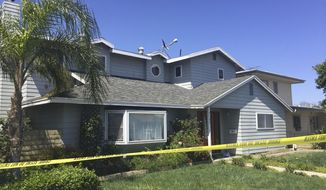 FILE - This May 16, 2018 file photo shows the home occupied by Stephen Beal in Los Beach, Calif. Beal, who was released in 2018 after his arrest on an explosives charge, was arrested Sunday, March 3, 2019, in connection with the May 15 bombing that killed Ildiko Krajnyak in her Orange County spa, said FBI spokeswoman Laura Eimiller. (AP Photo/Amanda Lee Myers, File)