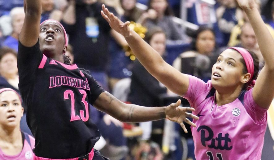 Louisville's Jazmine Jones (23) puts up a shot as Pittsburgh's Cara Judkins (11) defends during the second half of an NCAA college basketball game, Sunday, March 3, 2019, in Pittsburgh. (AP Photo/Keith Srakocic)
