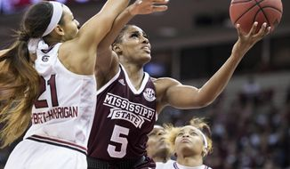 Mississippi State forward Anriel Howard (5) attempts to shoot against South Carolina forward Mikiah Herbert Harrigan (21) during the first half of an NCAA college basketball game Sunday, March 3, 2019, in Columbia, S.C. (AP Photo/Sean Rayford)
