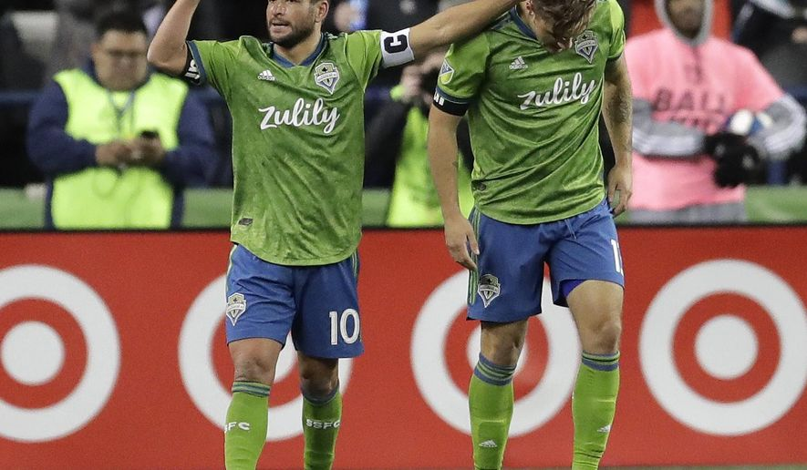 Seattle Sounders forward Jordan Morris, right, is greeted by midfielder Nicolas Lodeiro after Morris scored the first of his two first-half goals against FC Cincinnati during an MLS soccer match Saturday, March 2, 2019, in Seattle. Lodeiro assisted on the goal. (AP Photo/Ted S. Warren)
