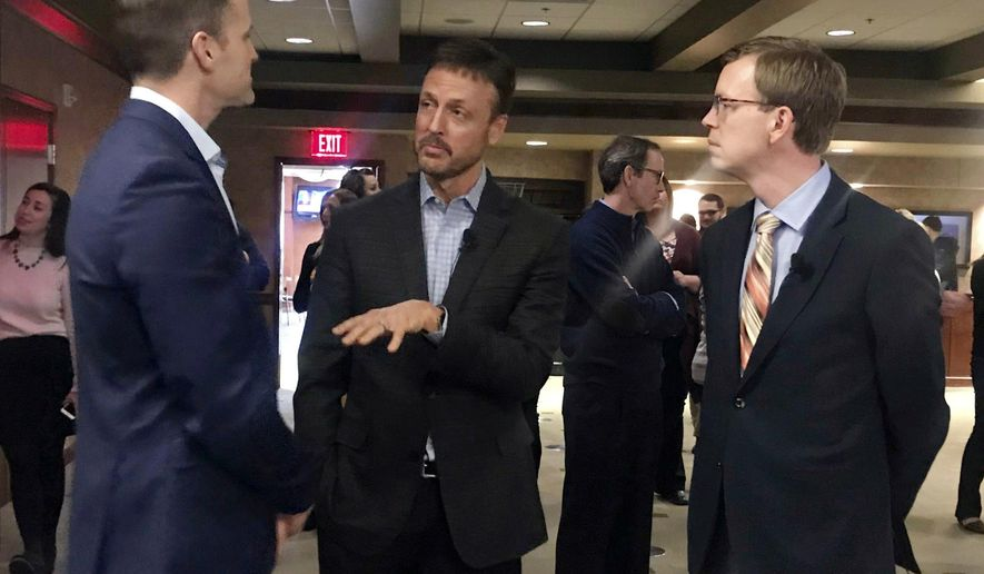 In this Monday, Feb. 25, 2019 photo, Poet CEO Jeff Broin, center discusses the biorefining process with Sioux Falls Mayor Paul TenHaken, left, and Congressman Dusty Johnson before a contract signing ceremony between Poet and the city of Sioux Falls, S.D.. (Joe Sneve/The Argus Leader via AP)