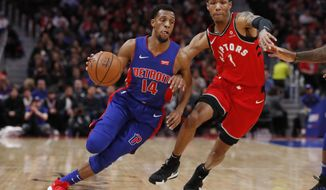 Detroit Pistons guard Ish Smith (14) drives against Toronto Raptors guard Patrick McCaw (1) during the first half of an NBA basketball game, Sunday, March 3, 2019, in Detroit. (AP Photo/Carlos Osorio)