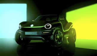 This undated picture provided by the Volkswagen car manufacturer shows a Volkswagen Buggy electric car. The new Volkswagen Buggy will be presented at the 'Geneva International Motor Show' which takes place in Geneva, Switzerland, from March 7 until March 17, 2019. Automakers are rolling out new electric and hybrid models at the show as they get ready to meet tougher emissions requirements in Europe - while not forgetting the profitable and popular SUVs and SUV-like crossovers. (Volkswagen via AP)