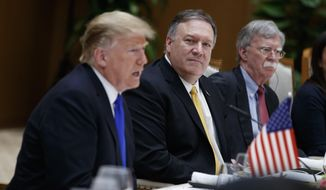 Secretary of State Mike Pompeo, center, and National Security Adviser John Bolton, right, listen as President Donald Trump speaks during a meeting with Vietnamese Prime Minister Nguyen Xuan Phuc at the Office of Government Hall, Wednesday, Feb. 27, 2019, in Hanoi. (AP Photo/ Evan Vucci) ** FILE **