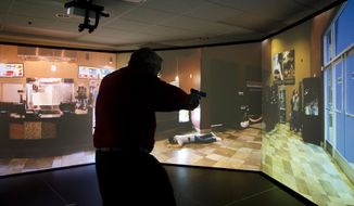 Police departments across the country increasingly are turning to simulators as training tools to replicate real-world scenarios without real-world costs. (Rod Lamkey Jr./Special to The Washington Times)