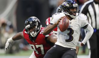 FILE - In this Dec. 2, 2018, file photo, Baltimore Ravens quarterback Robert Griffin III (3) runs out of the pocket as Atlanta Falcons defensive tackle Grady Jarrett (97) defends during the second half of an NFL football game in Atlanta. The Falcons have placed a franchise tag on Jarrett while saying they still hope to negotiate a long-term contract with the defensive tackle. (AP Photo/John Bazemore, File)