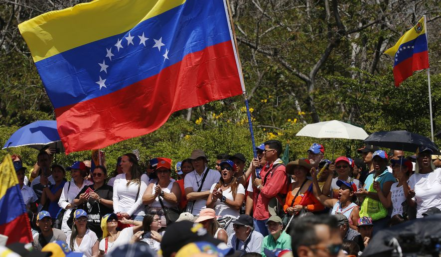 Anti-government protesters start to gather for a rally to demand the resignation of Venezuelan President Nicolas Maduro in Caracas, Venezuela, Monday, March 4, 2019. The United States and about 50 other countries recognize opposition Congress President Juan Guaido as the rightful president of Venezuela, while Maduro says he is the target of a U.S.-backed coup plot. (AP Photo/Fernando Llano)
