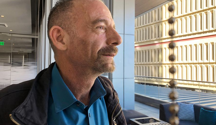 """Timothy Ray Brown poses for a photograph, Monday, March 4, 2019, in Seattle. Brown, also known as the """"Berlin patient,"""" was the first person to be cured of HIV infection, more than a decade ago. Now researchers are reporting a second patient has lived 18 months after stopping HIV treatment without sign of the virus following a stem-cell transplant. But such transplants are dangerous, cannot be used widely and have failed in other patients. (AP Photo/Manuel Valdes)"""