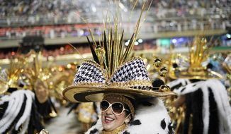 A performer from the Imperatriz Leopoldinense samba school parades during Carnival celebrations at the Sambadrome in Rio de Janeiro, Brazil, Monday, March 4, 2019. (AP Photo/Leo Correa)