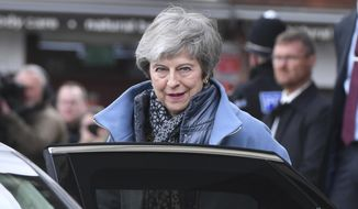 Britain's Prime Minister Theresa May leaves the Guildhall, in Salisbury, England, Monday, March 4, 2019, on the first anniversary of the Skripal poisoning. British authorities say they have completed the cleanup of the southwestern English city of Salisbury, where a former Russian spy was poisoned with a nerve agent. (Ben Birchall/PA via AP)