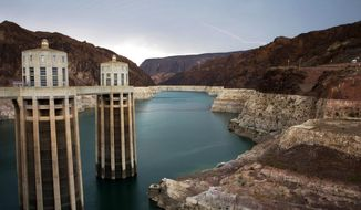 FILE - In this July 28, 2014, file photo, lightning strikes over Lake Mead near Hoover Dam that impounds Colorado River water at the Lake Mead National Recreation Area in Arizona. California and Arizona have missed a federal deadline for seven Western states to wrap up work on a plan to ensure the drought-stricken Colorado River can deliver water to millions of people who depend on it. (AP Photo/John Locher, File)
