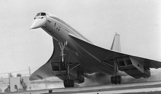 FILE - In this June 14, 1974 file photo, the Air France Concorde supersonic airliner touches down at Miami International Airport in Miami, Fla. The flight from Boston's Logan Airport took about 80 minutes. The Concorde's maiden flight was 50 years ago on March 2, 1969. Although the plane went out of service in 2003, its delta-wing design and drooping nose still make it instantly recognizable even to people who have never seen one in person. (AP Photo/Phil Sandlin, File)