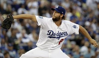 FILE - In this Oct. 28, 2018, file photo, Los Angeles Dodgers pitcher Clayton Kershaw winds up to throw during the first inning in Game 5 of the World Series baseball game against the Boston Red Sox in Los Angeles. Dodgers manager Dave Roberts says Kershaw is making steady progress in his recovery from left shoulder inflammation, but the ace may not be ready to start opening day. (AP Photo/David J. Phillip, File)