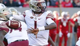 FILE - In this Nov. 3, 2018, file photo, Florida State quarterback James Blackman (1) looks to pass during the first half of an NCAA college football game against North Carolina State, in Raleigh, N.C. Blackman is clearly the Florida State's No. 1 quarterback after two-year starter Deondre Fancois was dismissed from the squad about a month ago. (AP Photo/Chris Seward, File)
