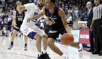 TCU guard Alex Robinson (25) defends as Kansas State guard Kamau Stokes (3) works to the basket for a shot in the first half of an NCAA college basketball game in Fort Worth, Texas, Monday, March 4, 2019. (AP Photo/Tony Gutierrez)