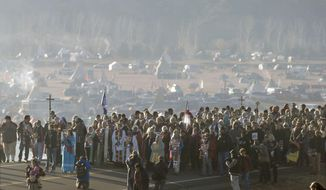 "FILE - This Nov. 11, 2016 file photo shows more than 500 clergy from across the country gathered for a ""Clergy for Standing Rock"" march on N.D. Highway 1806 near Cannon Ball, N. D., from the Oceti Sakowin Camp to the Cantapeta Creek bridge to demonstrate their solidarity for the Dakota Access Pipeline protesters. South Dakota Gov. Kristi Noem says she's proposing legislation ahead of the Keystone XL oil pipeline's construction that would create a legal avenue to pursue out-of-state money that funds protests aimed at slowing construction. Noem's bills come after opponents of the Dakota Access oil pipeline staged large protests that resulted in 761 arrests in southern North Dakota over a six-month span beginning in late 2016. The state spent tens of millions of dollars policing the protests. (Mike McCleary/The Bismarck Tribune via AP, File)"