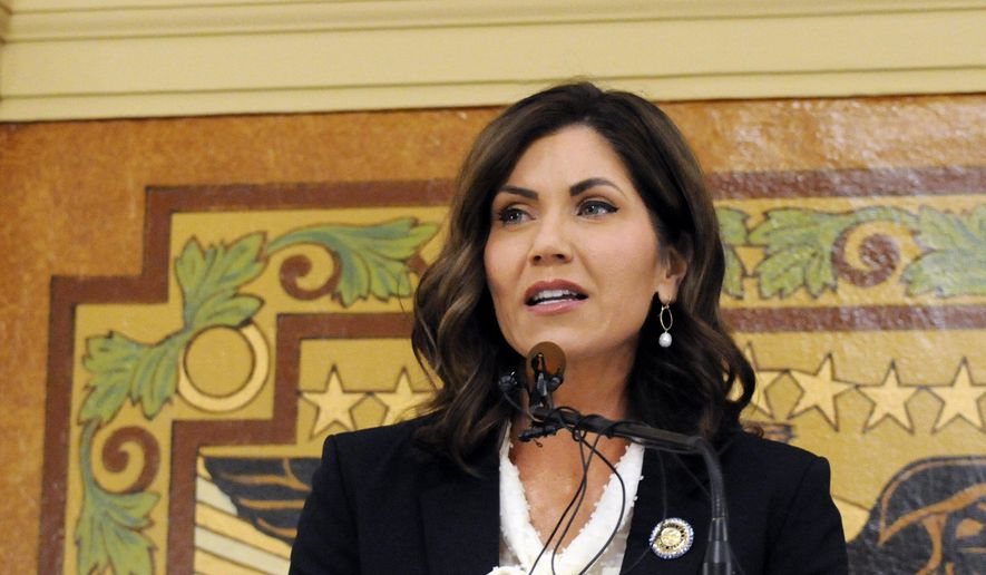 In this Jan. 8, 2019 file photo, South Dakota Gov. Kristi Noem gives her first State of the State address in Pierre, S.D. Noem says she's proposing legislation ahead of the Keystone XL oil pipeline's construction that would create a legal avenue to pursue out-of-state money that funds protests aimed at slowing construction. The Republican governor said Monday, March 4, 2019, that she wants to make sure Keystone XL and future pipelines are built safely and efficiently while shielding the state and counties from major law enforcement costs if there are riots. (AP Photo/James Nord, File) **FILE**