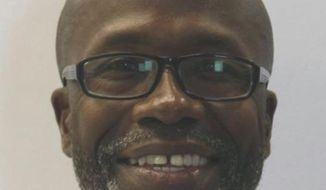 Keith Smith is shown in an undated photo provided by the Baltimore Police Department. On March 3, 2019 the Baltimore Police Department announced the apprehension and arrest of Keith Smith of Baltimore, and Valeria Shavon Smith, in the December 1, 2018 murder of Jacquelyn Anne Smith. Keith Smith was Jacquelyn Anne Smith's husband and Valeria Smith was her step-daughter. (Baltimore Police Department via AP)