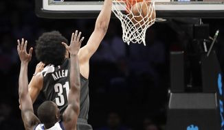 Brooklyn Nets center Jarrett Allen (31 dunks in front of Dallas Mavericks forward Dorian Finney-Smith, bottom, during the first half of an NBA basketball game, Monday, March 4, 2019, in New York. (AP Photo/Kathy Willens)