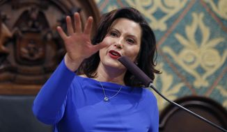 """FILE - Ion this Feb. 12, 2019 file photo, Michigan Gov. Gretchen Whitmer delivers her State of the State address to a joint session of the House and Senate at the state Capitol in Lansing, Mich. Whitmer wants to spend billions more to fix the roads and boost a lagging education system. But as the Democrat prepares to deliver her first budget proposal to the Republican-led Legislature, she faces fiscal and political pressures that are complicating her task. She notes the general fund has not grown much. The budget is Whitmer's chance to detail how she plans to """"fix the damn roads"""" and pay for priorities like letting high school graduates attend community college for free. (AP Photo/Al Goldis, File)"""