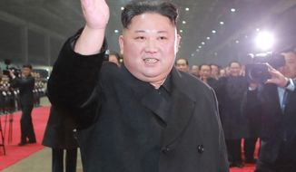 """In this March 5, 2019, photo provided by the North Korean government,  North Korean leader Kim Jong Un waves at Pyongyang station as Kim returned home on Tuesday after traveling a day and a half by train from Vietnam, where his high-stakes nuclear summit with President Donald Trump ended without any agreement, in Pyongyang. The content of this image is as provided and cannot be independently verified. Korean language watermark on image as provided by source reads: """"KCNA"""" which is the abbreviation for Korean Central News Agency. (Korean Central News Agency/Korea News Service via AP)"""