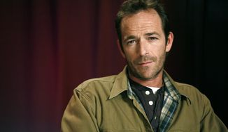 "FILE - In this Jan. 26, 2011 file photo, actor Luke Perry poses for a portrait in New York. Perry, who gained instant heartthrob status as wealthy rebel Dylan McKay on ""Beverly Hills, 90210,"" died Monday, March 4, 2019, after suffering a massive stroke, his publicist said. He was 52. (AP Photo/Jeff Christensen, File)"