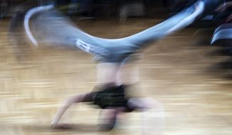 In this file picture taken with a long time exposure on March 12, 2017, Jannis Bednarzik performs during the German Breakdance Championships in Magdeburg, Germany. Getting hip to breakdancing's appeal with young audiences, organizers of the 2024 Paris Olympics want the dance sport that spread from New York in the 1970s to become a medal event at the games. (AP Photo/Jens Meyer, File)