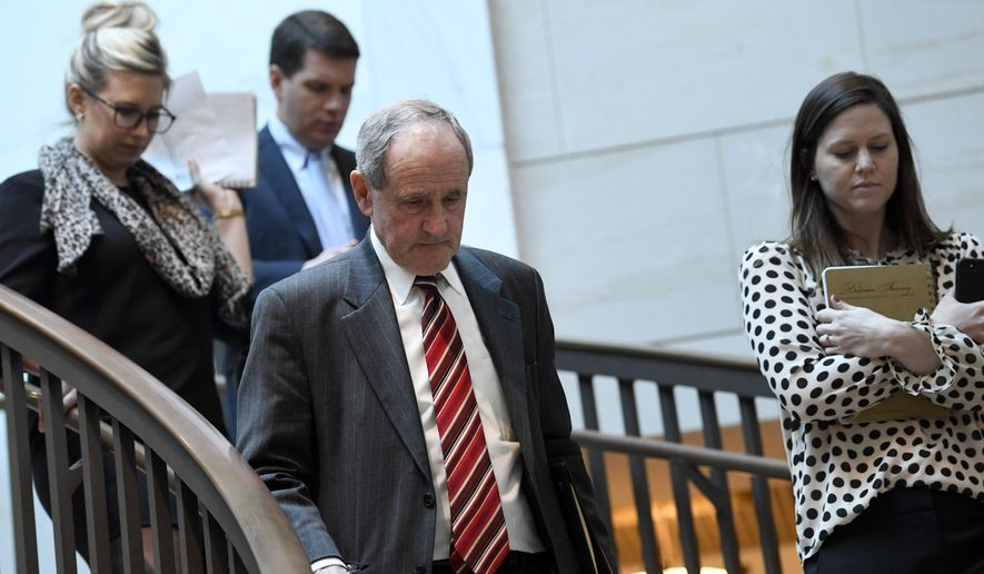 In this file photo, Senate Foreign Relations Committee Chairman Sen. Jim Risch, R-Idaho, left, heads to a closed-door briefing on Capitol Hill in Washington, Monday, March 4, 2019. (AP Photo/Susan Walsh) **FILE**