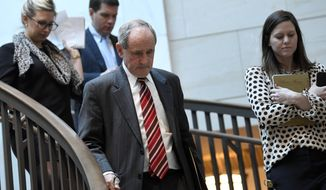 Senate Foreign Relations Committee Chairman Sen. Jim Risch, R-Idaho, left, heads to a closed-door briefing on Capitol Hill in Washington, Monday, March 4, 2019, on the global Magnitsky Act investigation related to the killing of journalist Jamal Khashoggi. (AP Photo/Susan Walsh)
