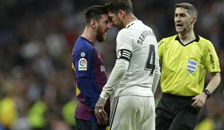 Barcelona forward Lionel Messi, left, goes head to head with Real defender Sergio Ramos after they argue during the Spanish La Liga soccer match between Real Madrid and FC Barcelona at the Bernabeu stadium in Madrid, Saturday, March 2, 2019. (AP Photo/Manu Fernandez)
