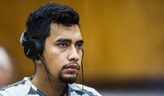 In this Sept. 19, 2018 file photo, Cristhian Bahena Rivera wears headphones during his arraignment where he pleaded not guilty to the charge of first-degree murder in the death of Mollie Tibbetts at the Poweshiek County Courthouse in Montezuma, Iowa. The Daily Iowan reports that 25-year-old Cristhian Bahena Rivera will now face trial beginning Feb. 4 in Woodbury County, rather than in November as earlier scheduled. (Kelsey Kremer/Des Moines Register via AP, Pool, File) **FILE**