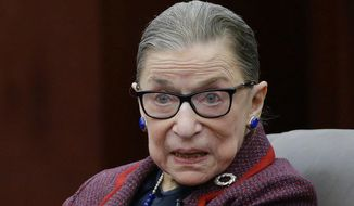 """In this Jan. 30, 2018, file photo, Supreme Court Justice Ruth Bader Ginsburg answers a law student's question as she participates in a """"fireside chat"""" in the Bruce M. Selya Appellate Courtroom at the Roger William University Law School in Bristol, R.I. (AP Photo/Stephan Savoia)"""