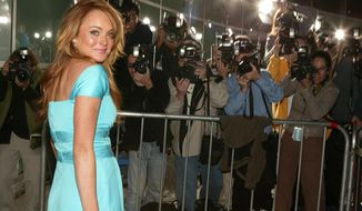 """Lindsay Lohan arrives to the premiere of  the film """"Mean Girls"""" at the Cinerama Dome in Los Angeles on Monday, April 19, 2004. (AP Photo/Chris Polk)"""