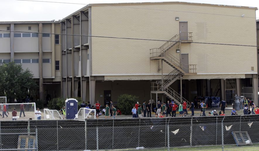 In this June 23, 2014, file photo, a temporary shelter for unaccompanied minors who have entered the country illegally is seen at Lackland Air Force Base, in San Antonio. (AP Photo/Eric Gay, File)