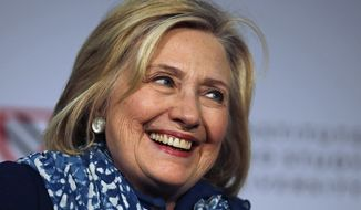 In this May 25, 2018 file photo, Hillary Clinton smiles as she is introduced at Harvard University in Cambridge, Mass.   (AP Photo/Charles Krupa) **FILE**
