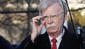 National Security Adviser John Bolton adjusts his glasses before an interview, Tuesday, March 5, 2019, at the White House in Washington. (AP Photo/Jacquelyn Martin)