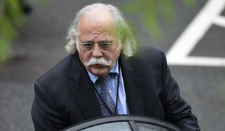 In this May 17, 2018, file photo, then-White House lawyer Ty Cobb gets into his car at the White House in Washington. The former White House special counsel considers special prosecutor Robert Mueller an American hero. (AP Photo/Susan Walsh, File)