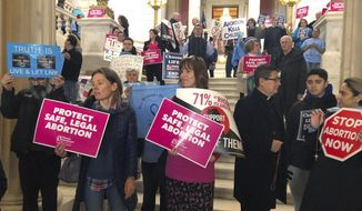 People both supporting and opposing abortion protest at the Statehouse, Tuesday, March 5, 2019, in Providence, R.I., where a house committee is set to vote whether to enshrine abortion protections in state law, joining states around the country that are revisiting their laws in anticipation of renewed federal fights over abortion. (AP Photo/Jennifer McDermott) ** FILE **