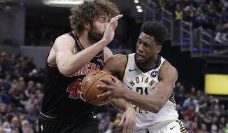 Indiana Pacers' Thaddeus Young (21) goes to the basket against Chicago Bulls' Robin Lopez (42) during the first half of an NBA basketball game Tuesday, March 5, 2019, in Indianapolis. (AP Photo/Darron Cummings)