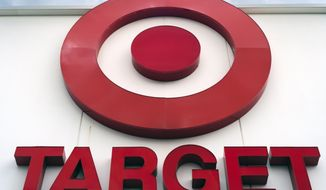 FILE - This May 3, 2017, file photo shows a Target store in Omaha, Neb. Strong online sales and more shoppers helped push Target's fourth-quarter results past Wall Street's expectations. The chain's remodeling and expanded delivery services enticed shoppers to buy during the critical holiday season. The retailer reported a 31 percent jump in comparable digital sales, with same-store sales up 5.3 percent.  (AP Photo/Nati Harnik, File)