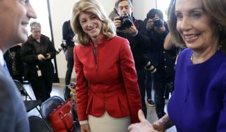 Former state senator Wendy Davis, center, visits with Speaker of the House Nancy Pelosi, D-Calif., right, following a stop for a news conference, Tuesday, March 5, 2019, in Austin, Texas. (AP Photo/Eric Gay)