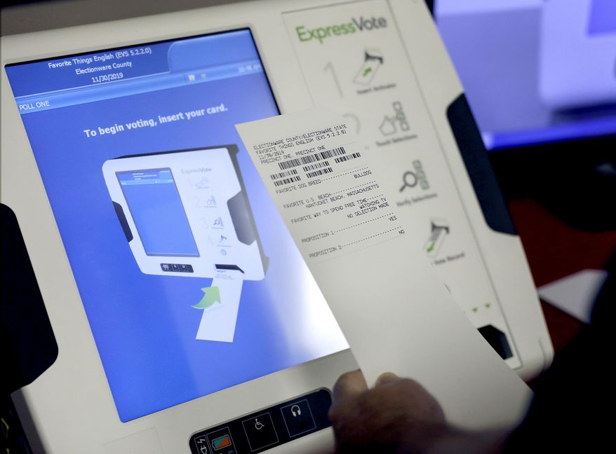 This Oct. 19, 2017, file photo shows a new voting machine which prints a paper record on display at a polling site in Conyers, Ga. (AP Photo/David Goldman, File)